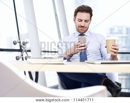 Business Person Looking At Cellphone
