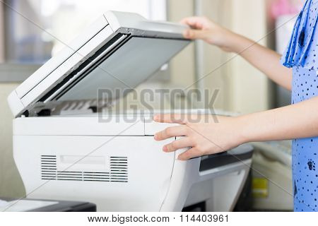 Woman's Hand With Working Photocopy