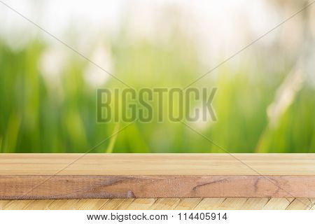 Wooden Board Empty Table blur trees in forest - can be used mock up for display or montage.