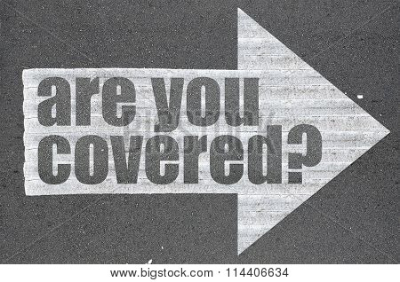 Arrow On Asphalt Road Written Word Are You Covered?