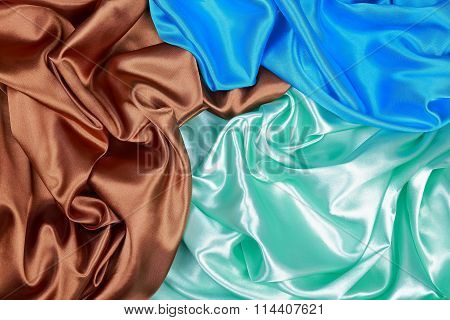 Blue And Brown And Light Green Silk Satin Cloth Of Wavy Folds Texture Background