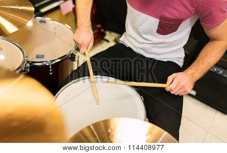 close up of male musician playing on drum kit