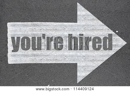 Arrow On Asphalt Road Written Word You're Hired