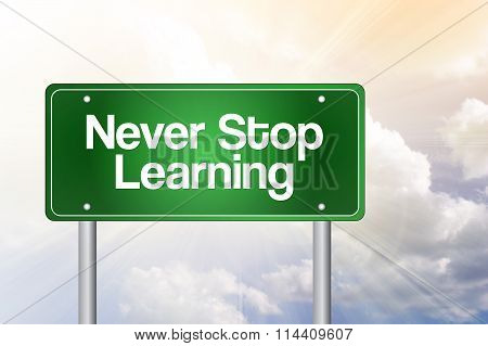 Never Stop Learning Green Road Sign, Business Concept..