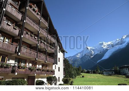 Traditional European Alpine Ski Chalet Hotel, View Of The Alps In The Distance.  Copy Space