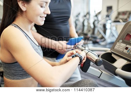 close up of woman setting heart-rate watch at gym