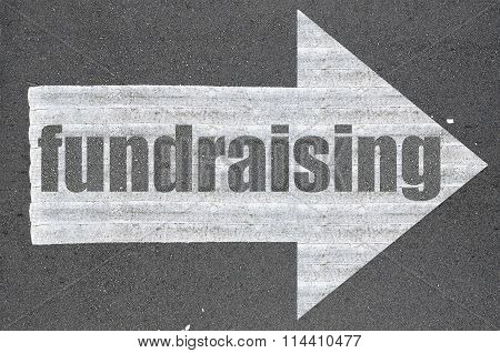 Arrow On Asphalt Road Written Word Fundraising