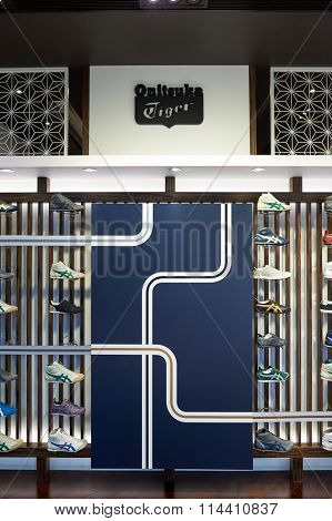 HONG KONG - DECEMBER 25, 2015: Onitsuka Tiger footwear in the store. Onitsuka Tiger is one of the oldest shoe companies in Japan.