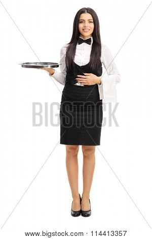 Full length portrait of a young waitress holding a gray metal tray and a white towel isolated on white background