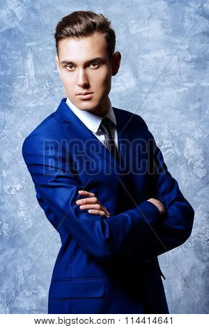 Vogue shot of a handsome young man in elegant classic suit. Men's beauty, fashion.