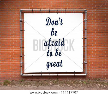 Large Banner With Inspirational Quote On A Brick Wall