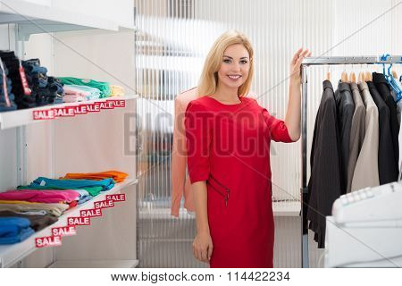 Beautiful Saleswoman Standing In Clothing Store