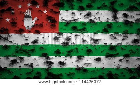 Flag of Abkhazia painted on wall with bullet holes