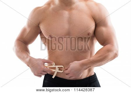 Strong Man Measuring Fats With Caliper