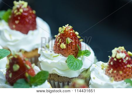 Strawberry Cupcak Topping With Pistachio And Cream,selective Focus