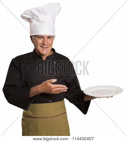 Confident Mature Chef In Black Uniform Holding Empty Plate.