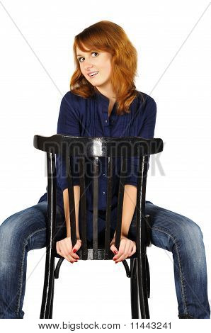 Portrait Of Beautiful Cute Smiling Brown-eyed Girl Sitting On Chair