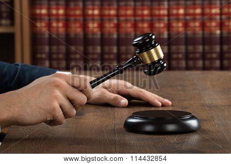 Judge Hitting Gavel At Desk