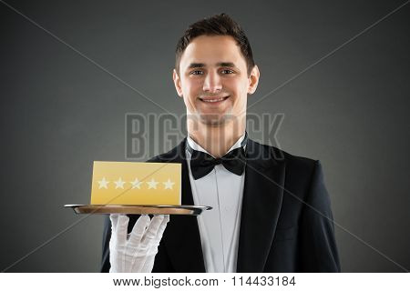 Happy Waiter Holding Tray With Star Rating Label