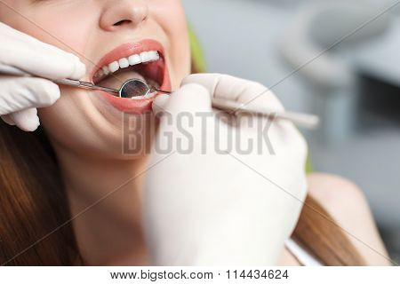 Professional dental doctor is treating female health