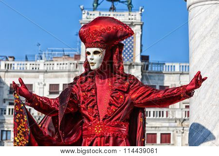 Mask in beautiful red costume at Venice Carnival