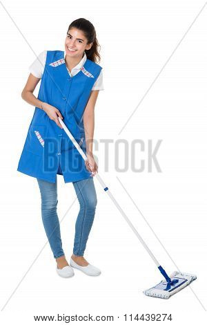 Happy Female Janitor Mopping On White Background