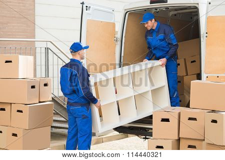Movers Unloading Furniture From Truck