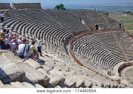 Denizli Turkey - June 12 2015: Guide and tourists in Hierapolis amphitheater Pamukkale town Denizli Turkey