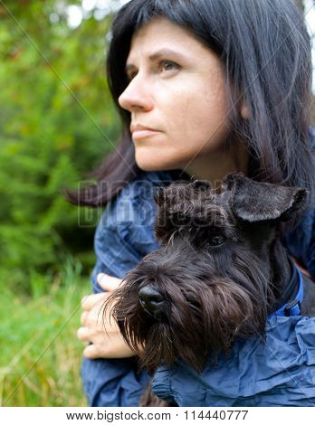 Woman With Her Dog In Nature