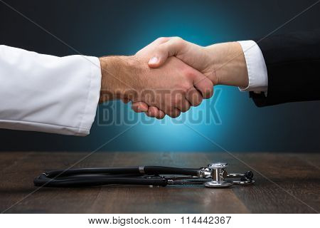Cropped Image Of Businessman And Doctor Shaking Hands