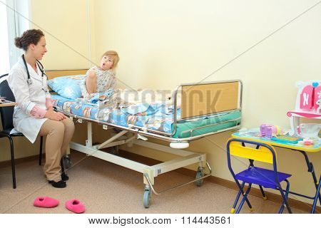 RUSSIA, MOSCOW - AUG 31, 2015: Young girl communicates to health worker hospital ward in multidisciplinary Clinic Center Endosurgery and Lithotripsy (CELT) (woman with release)
