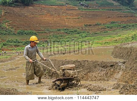 man is working the soil by manual cultivator in village CatCat, Vietnam
