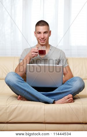 guy with laptop and tea