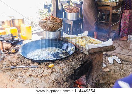 Preparing Lunch At A Weekly Market On Inle Lake, Myanmar (burma)