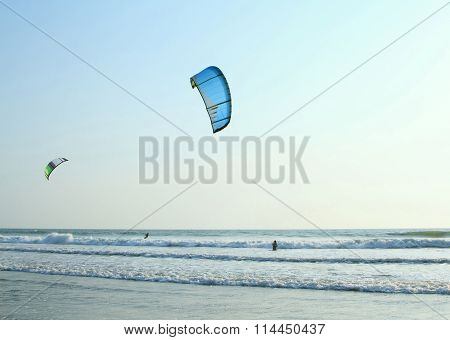 Kiteboarder Enjoy Surfing In The Ocean