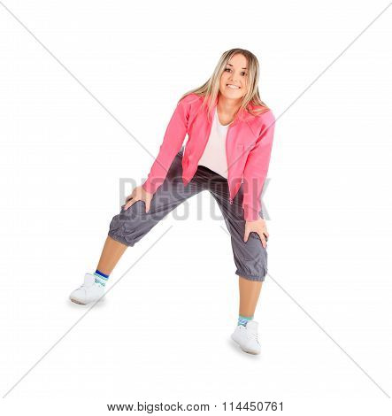 Young smiling woman in sportwear isolated over white