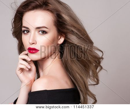 Portrait of beautiful blonde woman with curly hairstyle and bright makeup perfect skin skincare spa