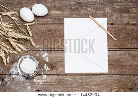 The Flour  And Eggs On An Wooden Background
