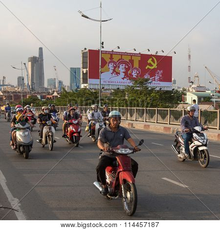 HO CHI MINH, VIETNAM - JAN 10, 2015: Motorcycle traffic in Ho Chi Minh city. Is located in the South of Vietnam, is the country's largest city, population 8 million.