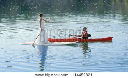 Happy Couple On Vacation Sport Kayak Sup Newlyweds