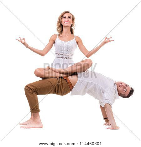 Surprised young couple on white background, isolated