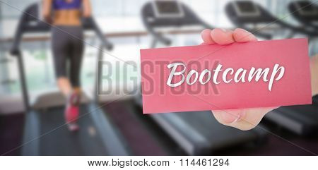 The word bootcamp and hand showing card against