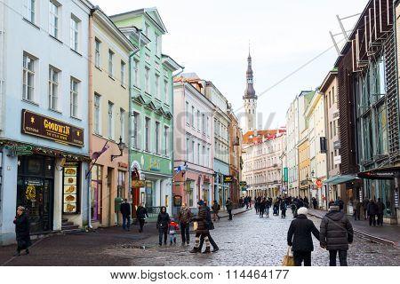 TALLINN, ESTONIA - DECEMBER 25: People walking on the street in old city on December 25, 2015 in Tallinn, Estonia