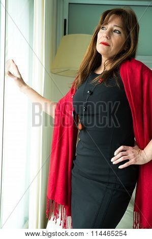 Beautiful Mature Woman Looking Out Of The Window