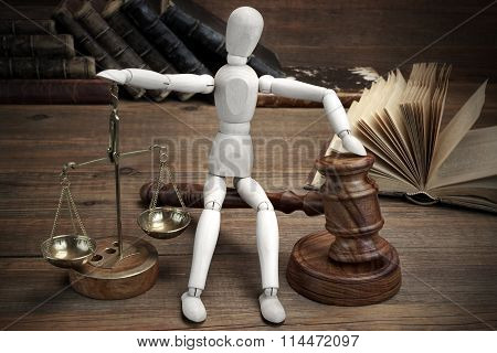 Wooden Figurine With Judges Gavel And Scale Of Justice