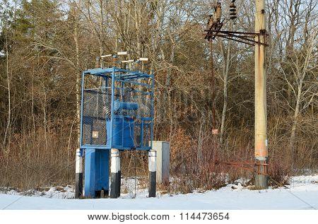 Transformer box near a forest in winter