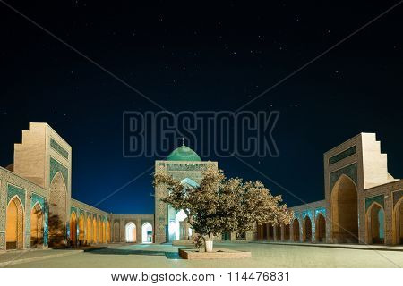 Ancient complex of buildings of Poi Kalyan with starry sky, Bukhara, Uzbekistan
