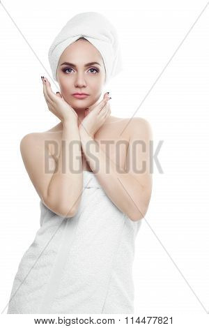 Gorgeous girl with dark hair and dark eyebrows, wearing white towel on head, holding hands near face