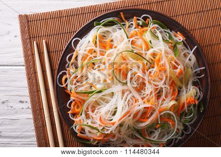 Glass Noodle Salad With Cucumber And Carrot Close-up. Horizontal Top View