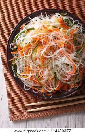 Glass Noodle Salad With Cucumber And Carrot Close-up. Vertical Top View